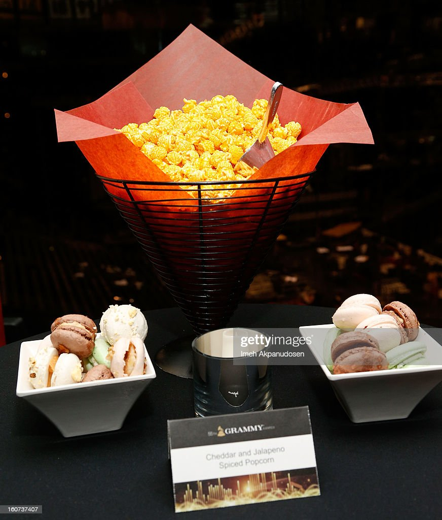 A preview of cheddar and jalapeno spiced popcorn and assorted savory macaroons during a behind the scenes kitchen tour and suite menu tasting for the 55th Annual GRAMMY Awards at Staples Center on February 4, 2013 in Los Angeles, California.
