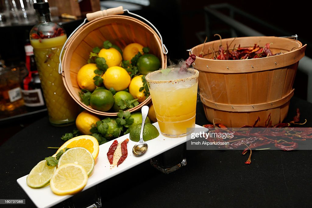 A preview of Herradura tequila topped with a Chile de Arbol pepper, fresh lime juice, Grand Marnier brandy liqueur, dry ice with a cilantro pepper and salt brim during a behind the scenes kitchen tour and suite menu tasting for the 55th Annual GRAMMY Awards at Staples Center on February 4, 2013 in Los Angeles, California.