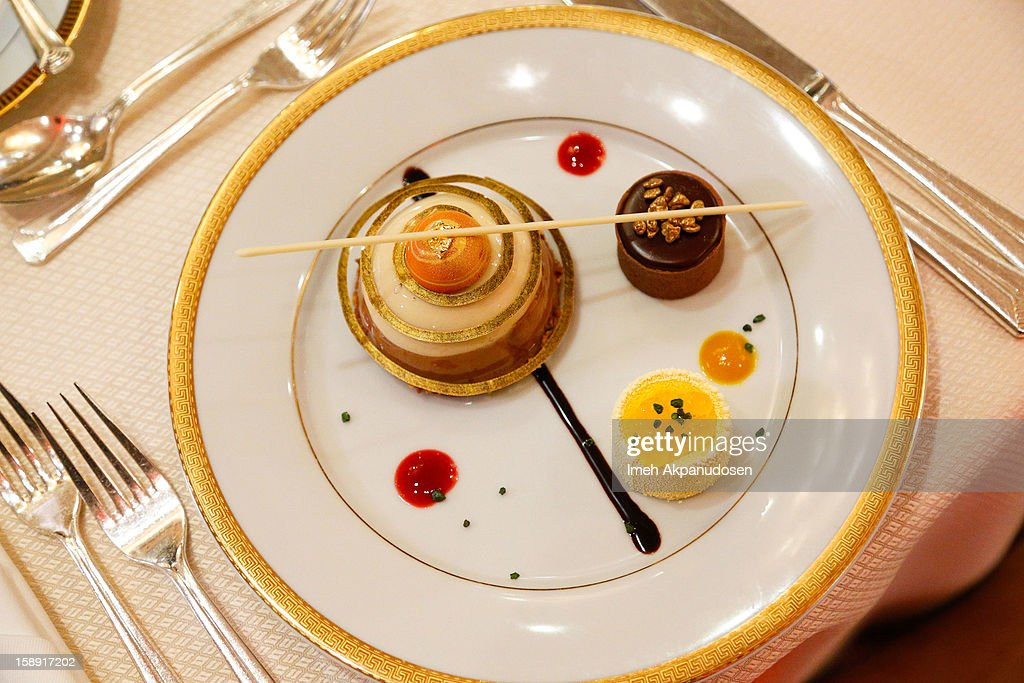 A preview of the cappuccino mousse dome, orange sanguine and chocolate salted caramel dessert prepared by executive pastry chef Thomas Henzi for the 2013 Golden Globe Awards at The Beverly Hilton Hotel on January 3, 2013 in Beverly Hills, California.