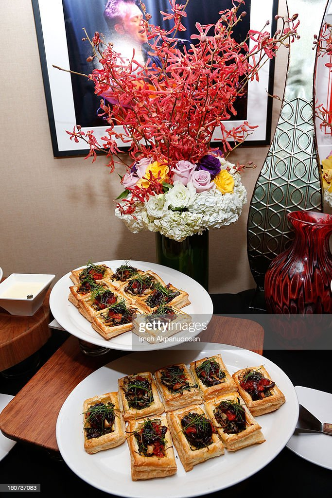 A preview of the wild California Coastal mushroom tart served with Chianti glazed shallots, roasted tomato confit, and thyme-basil pesto during a behind the scenes kitchen tour and suite menu tasting for the 55th Annual GRAMMY Awards at Staples Center on February 4, 2013 in Los Angeles, California.