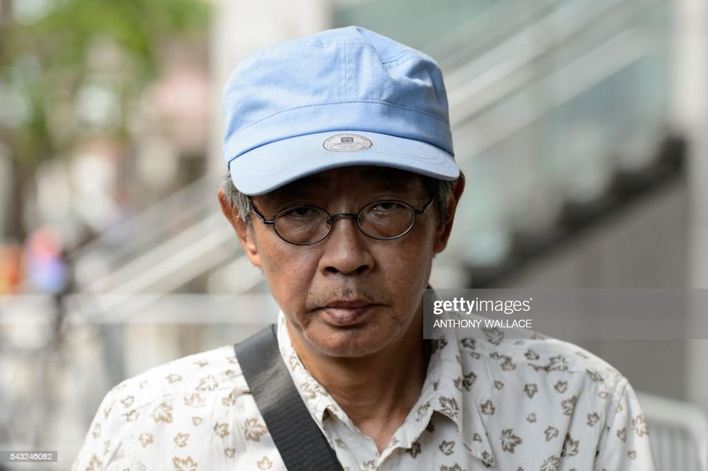 Previously missing Hong Kong bookseller Lam Wing-kee arrives at Wanchai police station to report to the police in Hong Kong on June 27, 2016. Lam is one of five city booksellers known for selling gossipy titles about Beijing politicians who have disappeared and later resurfaced in China. Lam claimed he was kept in a cell, blindfolded and interrogated. / AFP / ANTHONY
