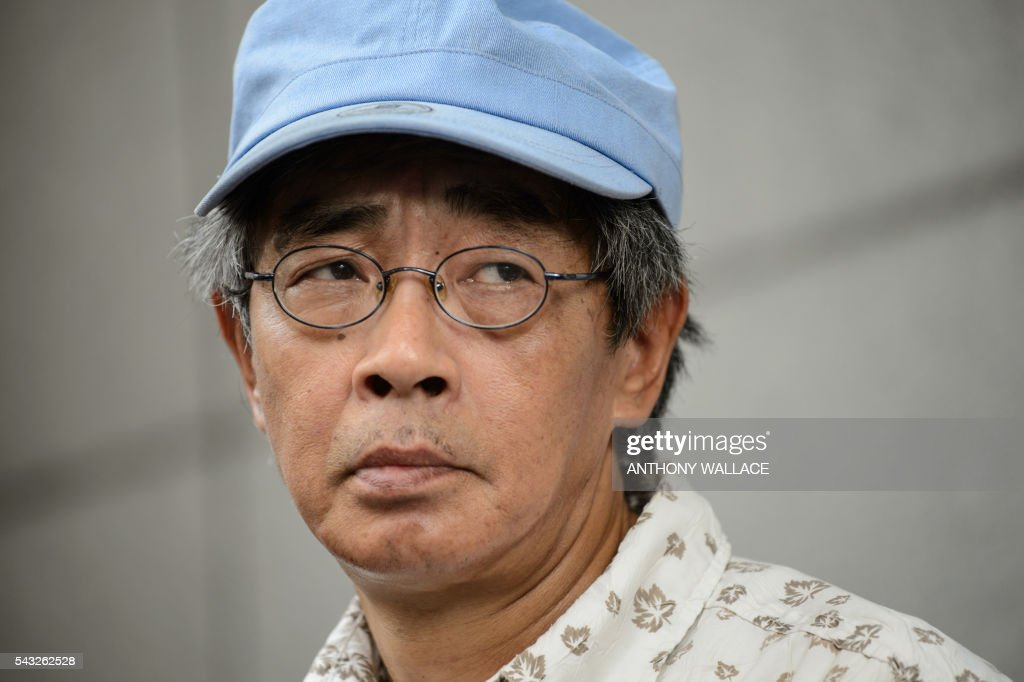 Previously missing Hong Kong bookseller Lam Wing-kee looks on as he holds a press conference outside Wanchai police station after reporting to the police in Hong Kong on June 27, 2016. Lam is one of five city booksellers known for selling gossipy titles about Beijing politicians who have disappeared and later resurfaced in China. He claimed he was kept in a cell, blindfolded and interrogated. / AFP / ANTHONY