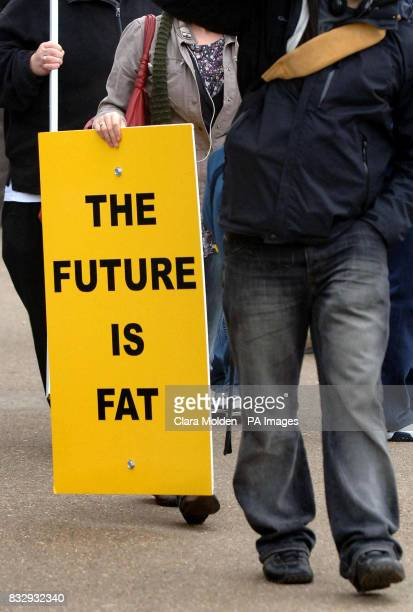 Previously unissued photo dated 180207 of a woman carrying a sign that says 'The future is fat' in Hyde Park London A common gene variant found in...