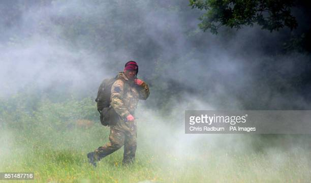 Previously unissued photo of a member of the Parachute Regiment walking through smoke during a house clearance exercise at Fingringhoe Ranges in...