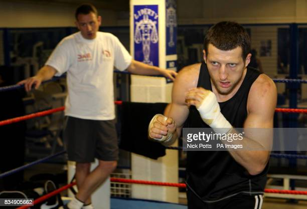 Previously unissued photo of Carl Froch shadow boxing while watched by trainer Robert McCracken during a training session at the Liberty Gym in...