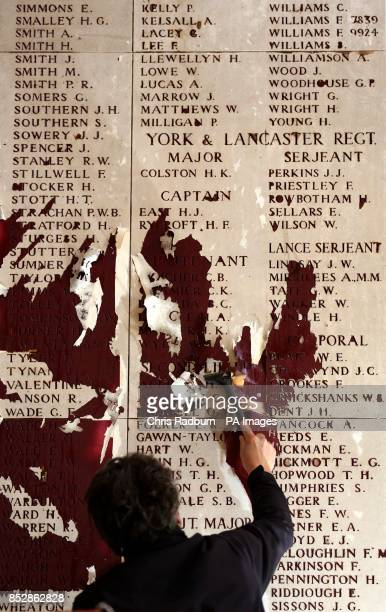 Previously unreleased image dated 05/11/13 Danny Delplace carries out restoration work to the names on the Menin Gate memorial Ypres Belgium as the...