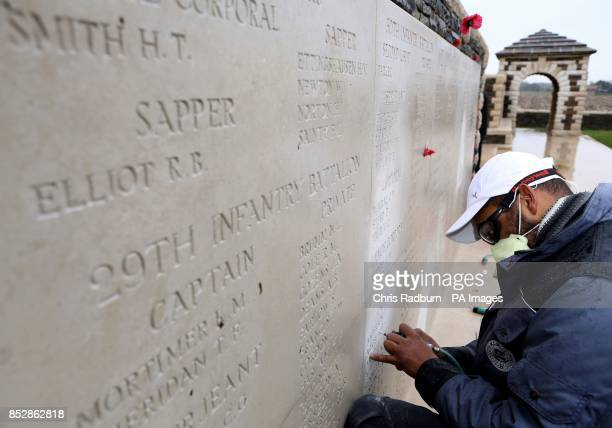 Previously unreleased image dated 06/11/13 of stone mason JeanMaurice Van d'Huyslager carries out restoration works on the names on the memorial wall...