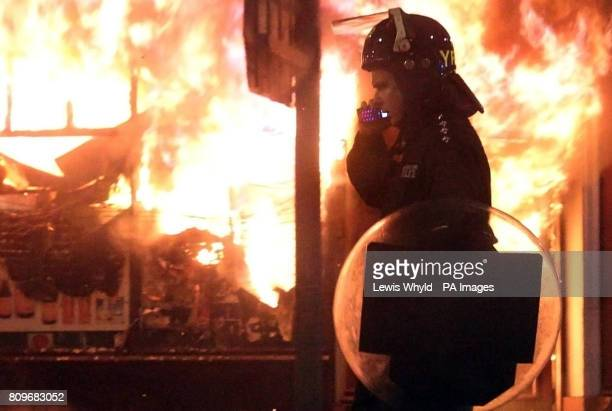 Previously unreleased photo dated 08/08/11 of riot police during the disturbances in Tottenham north London as police were forced to use their own...