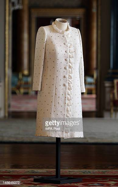 A previously unreleased photo of the ivory dress and coat which Queen Elizabeth II has worn for the Thames Diamond Jubilee Pageant on June 3 2012 in...