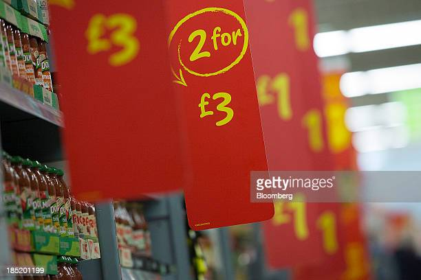 Price labels alert customers to multipurchase deals on a display shelf inside an Asda supermarket the UK retail arm of WalMart Stores Inc in Watford...