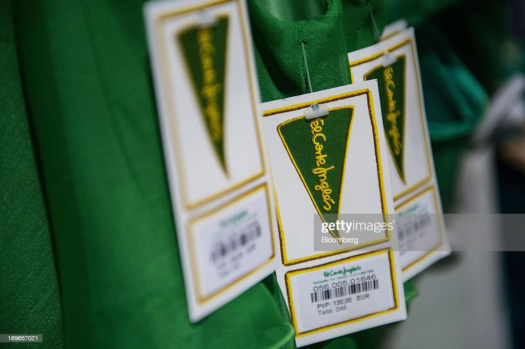 Price labels hang from clothing for sale inside an El Corte Ingles SA department store in Barcelona, Spain, on Thursday, May 30, 2013. Spain's recession eased in the first quarter as domestic demand stabilized while exports, which the government says will drive the recovery of the euro-area's fourth-largest economy, fell at the fastest pace in a year. Photographer: David Ramos/Bloomberg via Getty Images