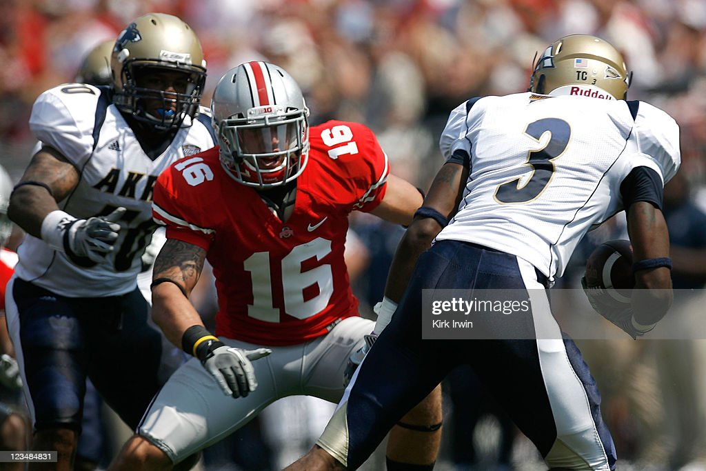 A.J. Price #3 of the Akron Zips attempts to run past Zach Domicone #16 of the Ohio State Buckeyes during the second quarter on September 3, 2011 at Ohio Stadium in Columbus, Ohio. Ohio State defeated Akron 42-0.