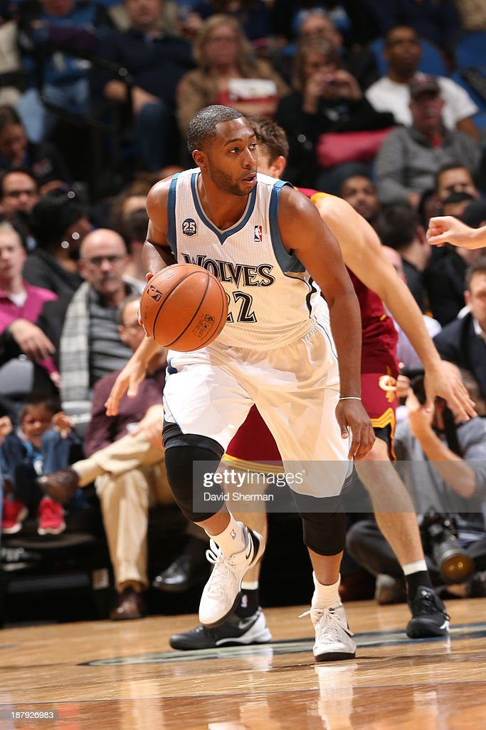 A.J. Price #22 of the Minnesota Timberwolves dribbles the ball against the Cleveland Cavaliers on November 13, 2013 at Target Center in Minneapolis, Minnesota.
