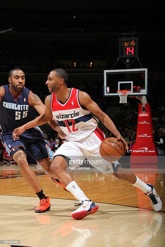 A.J. Price #12 of the Washington Wizards drives against Reggie Williams #55 of the Charlotte Bobcats during the game at the Verizon Center on March 9, 2013 in Washington, DC.