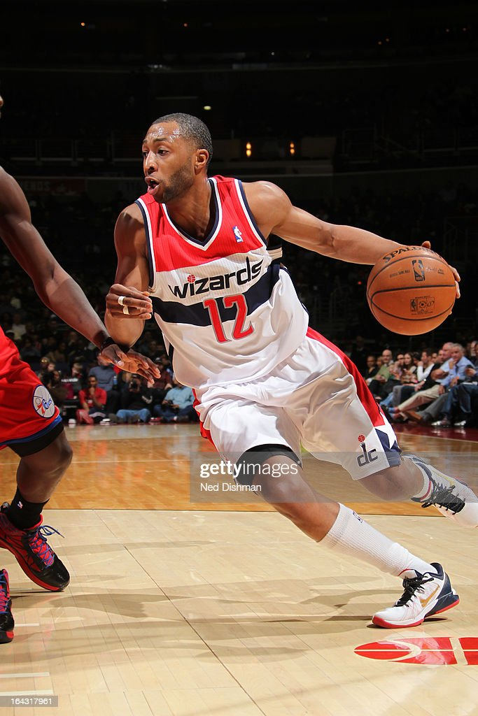 A.J. Price #12 of the Washington Wizards drives to the basket against the Philadelphia 76ers at the Verizon Center on March 3, 2013 in Washington, DC.