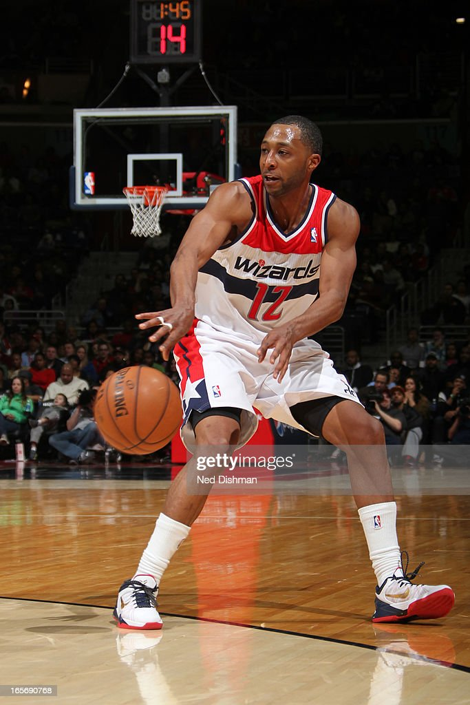 A.J. Price #12 of the Washington Wizards passes the ball against the Charlotte Bobcats at the Verizon Center on March 9, 2013 in Washington, DC.