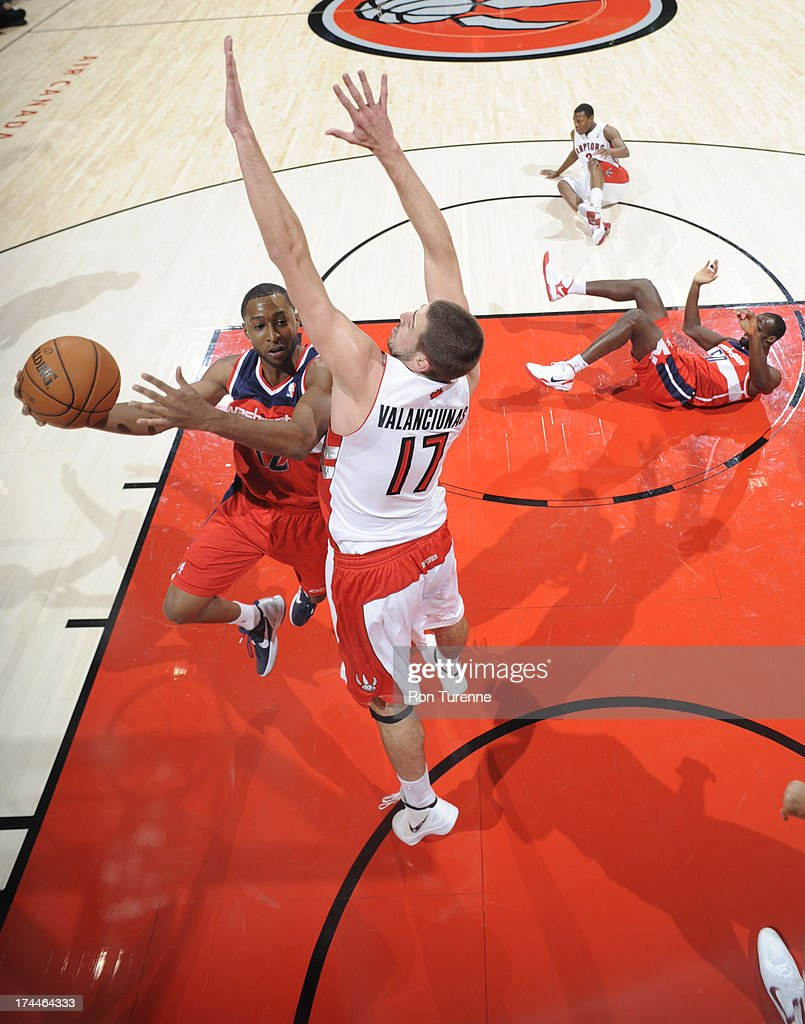 A.J. Price #12 of the Washington Wizards rises for a layup against <a gi-track='captionPersonalityLinkClicked' href=/galleries/search?phrase=Jonas+Valanciunas&family=editorial&specificpeople=5654195 ng-click='$event.stopPropagation()'>Jonas Valanciunas</a> #17 of the Toronto Raptors during a pre-season game on October 17, 2012 at the Air Canada Centre in Toronto, Ontario, Canada.
