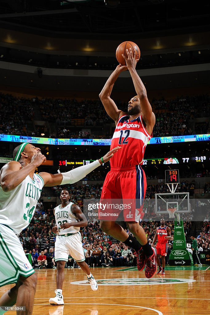 A.J. Price #12 of the Washington Wizards shoots over <a gi-track='captionPersonalityLinkClicked' href=/galleries/search?phrase=Paul+Pierce&family=editorial&specificpeople=201562 ng-click='$event.stopPropagation()'>Paul Pierce</a> #34 of the Boston Celtics on April 7, 2013 at the TD Garden in Boston, Massachusetts.