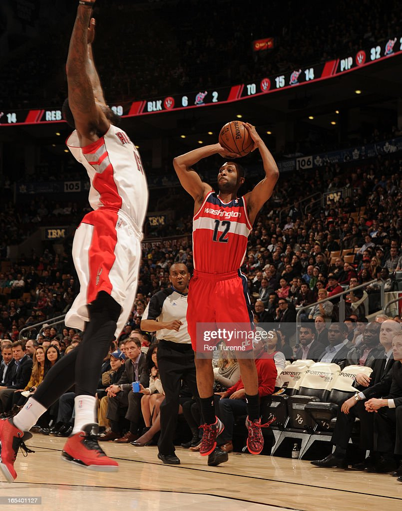 A.J. Price #12 of the Washington Wizards shoots the ball against the Toronto Raptors during the game on April 3, 2013 at the Air Canada Centre in Toronto, Ontario, Canada.