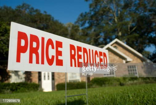 Price reduced real estate sign : Stock Photo
