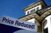 A price reduction notice is displayed on a house up for sale February 14 2008 in San Rafael California Home sales dropped nearly 42 percent from...