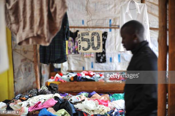 A price sign hangs above secondhand clothes for sale in a store at the Toi market in the outskirst of Kibera slum in Nairobi Kenya on Tuesday Aug 15...