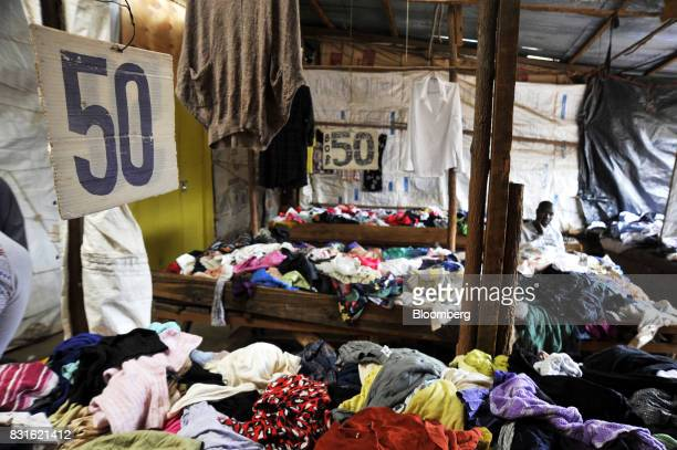 A price sign hangs above secondhand clothes for sale in an empty store at the Toi market in the outskirst of Kibera slum in Nairobi Kenya on Tuesday...