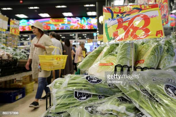 A price sign sits on vegetables at a Super Tamade KK supermarket in the Tenjinbashi district of Osaka Japan on Monday Oct 9 2017 Amid the gloom and...