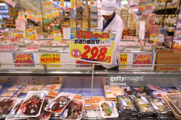 A price sign stands above seafood on display for sale at a Super Tamade KK supermarket in the Tenjinbashi district of Osaka Japan on Monday Oct 9...