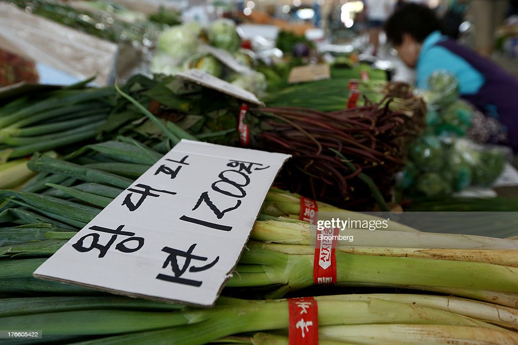 A price tag for scallions is displayed at Samsan Agricultural Wholesale Market in Incheon, South Korea, on Friday, Aug. 16, 2013. South Korean producer prices declined 0.9 percent in July from a year earlier after a 1.4 percent drop in June, the central bank said in a statement today. Photographer: SeongJoon Cho/Bloomberg via Getty Images