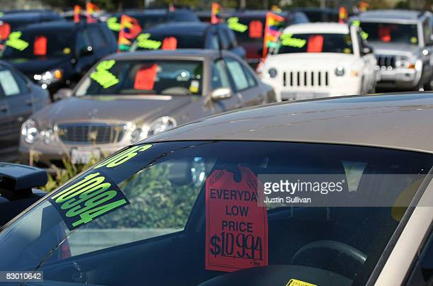 A price tag hangs from the rear view mirror of a car for sale at a Chrysler dealership September 25 2008 in Colma California The Commerce Department...
