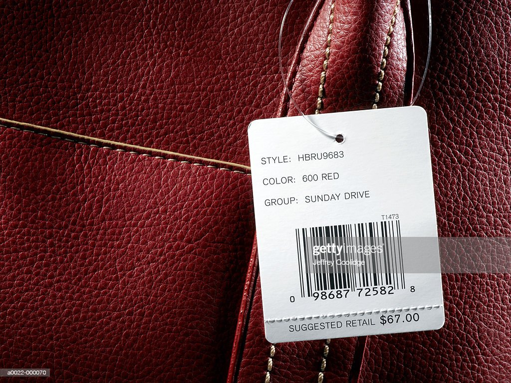 Price Tag on Leather Handbag : Stock Photo