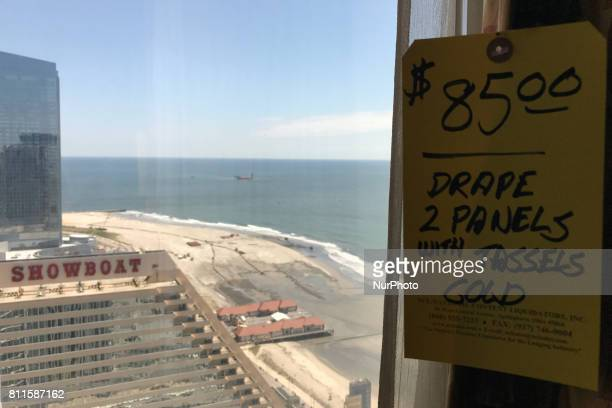 Price tags hang from sheer curtains at the 49th floor of the former Trump Taj Mahal Casino and Resort during the liquidation sale on July 8 in...