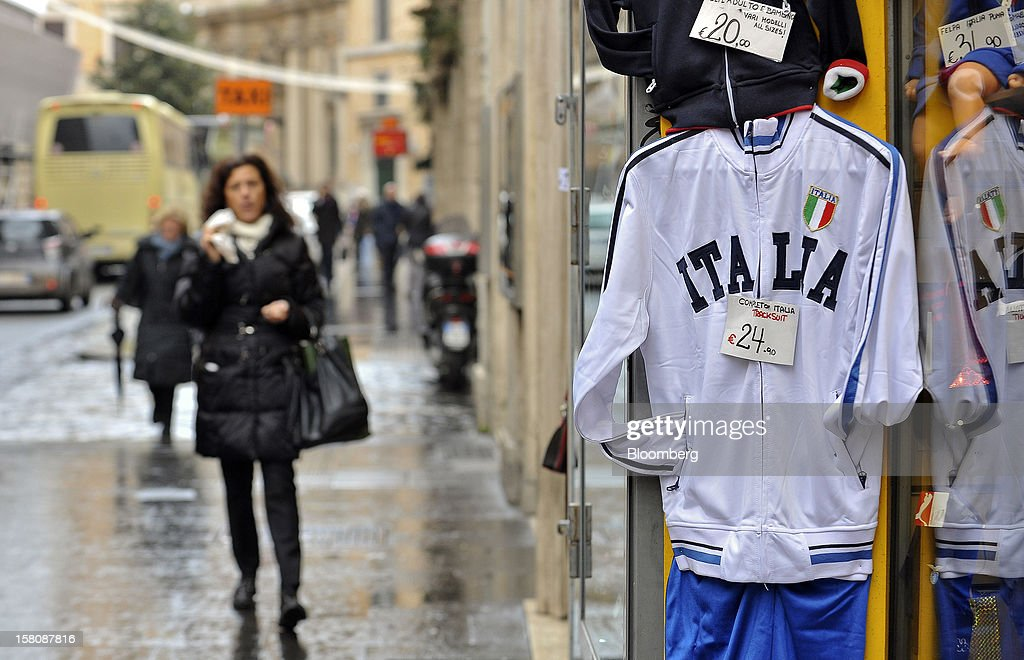 Price tags hang on tracksuits bearing the 'Italia' logo outside a souvenir store in Rome, Italy, on Monday, Dec. 10, 2012. The imminent end of Prime Minister Mario Monti's government fueled the largest increase in Italian borrowing costs in four months and threatened to open a new front in Europe's crisis fight before a year-end summit. Photographer: Victor Sokolowicz/Bloomberg via Getty Images