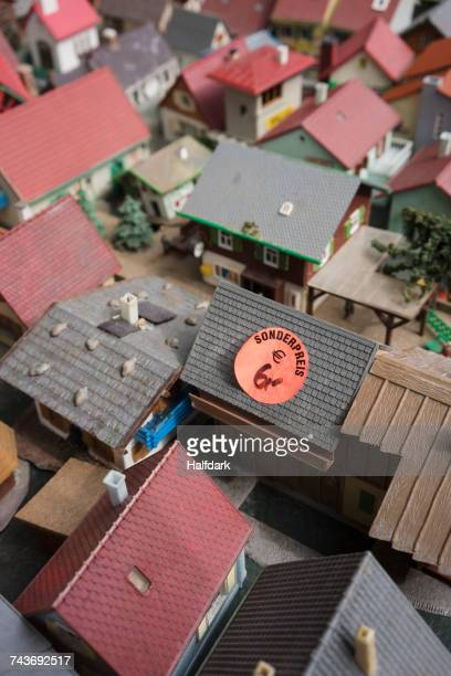 Price tags on roofs of model houses for sale
