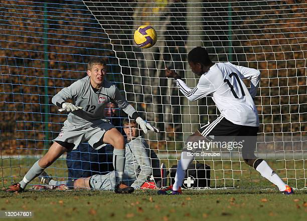 PriceOsei Owusu of Germany scores his team's second goal against goalkeeper Adrian Szady of Poland during the U15 International Friendly match...