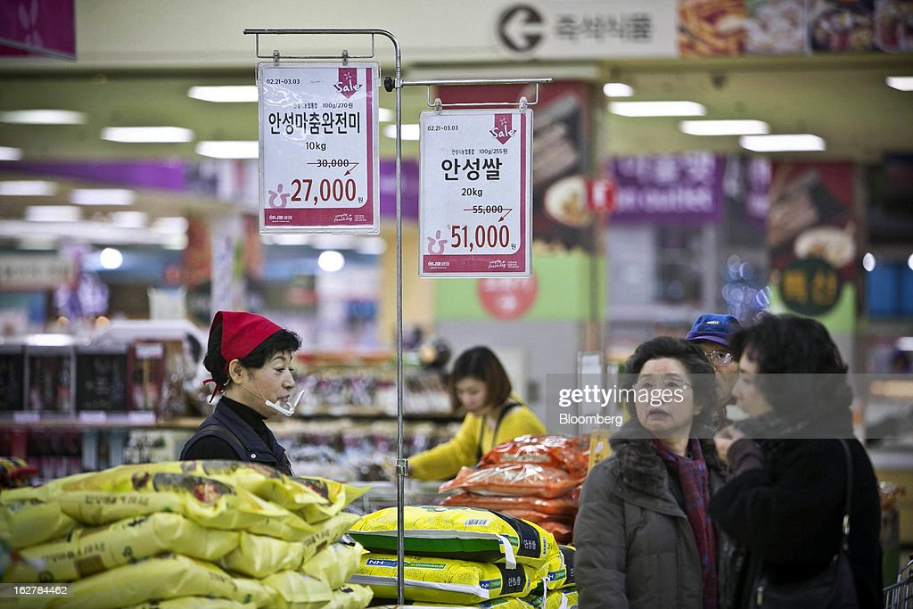 Prices are displayed as shoppers browse goods at Hanaro Mart in Seoul, South Korea, on Tuesday, Feb. 26, 2013. South Korean consumer confidence remained at its highest level since May as gains in the won drove down the prices of imported goods. Photographer: Jean Chung/Bloomberg via Getty Images