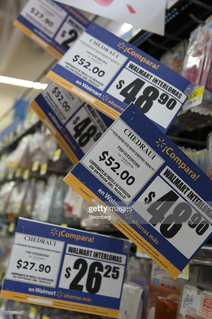 Prices are displayed in an aisle at a Wal-Mart Stores Inc. location in Mexico City, Mexico, on Thursday, June 20, 2013. Mexican retail sales rose 2.5 percent in April from the same month last year, the country's statistics agency, known as Inegi, reported on its website. Photographer: Susana Gonzalez/Bloomberg via Getty Images