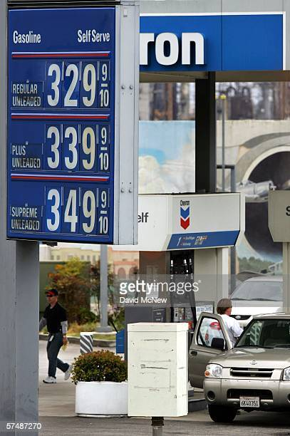 Prices are posted at a Chevron gas station near the companys El Segundo Refinery while the company's profits rise and the local price of gas hovers...