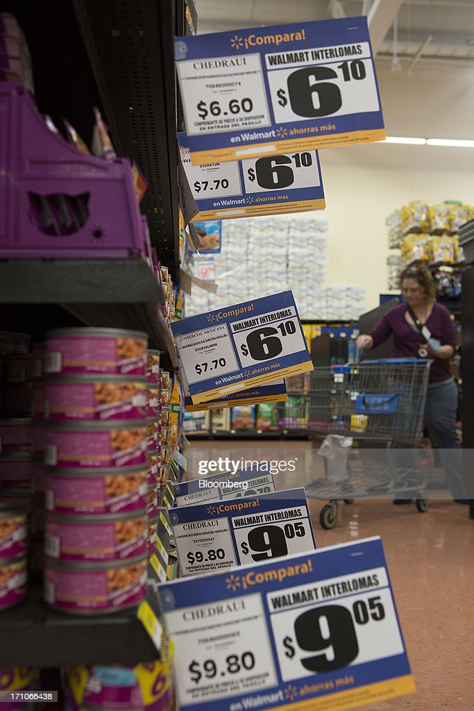 Prices for pet food are displayed at a Wal-Mart Stores Inc. location in Mexico City, Mexico, on Thursday, June 20, 2013. Mexican retail sales rose 2.5 percent in April from the same month last year, the country's statistics agency, known as Inegi, reported on its website. Photographer: Susana Gonzalez/Bloomberg via Getty Images
