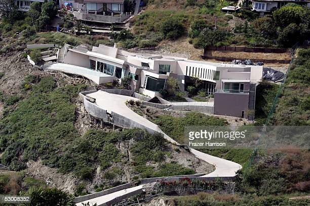 A pricey southern California home lies in ruins after a landslide sent structures crashing down a hill June 1 2005 in Laguna Beach California...