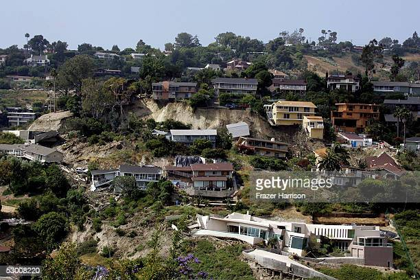 Pricey southern California homes lie in ruins after a landslide sent the structures crashing down a hill June 1 2005 in Laguna Beach California...