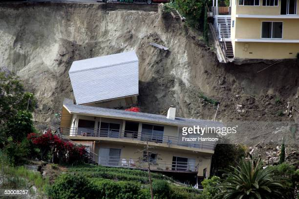 Pricey southern California homes lie in ruins after a landslide sent structures crashing down a hill June 1 2005 in Laguna Beach California Eighteen...