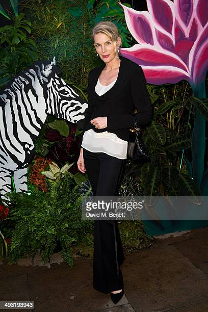 Pricilla Waters arrives at Roger Vivier Summer Party at Loulou's on May 22 2014 in London England