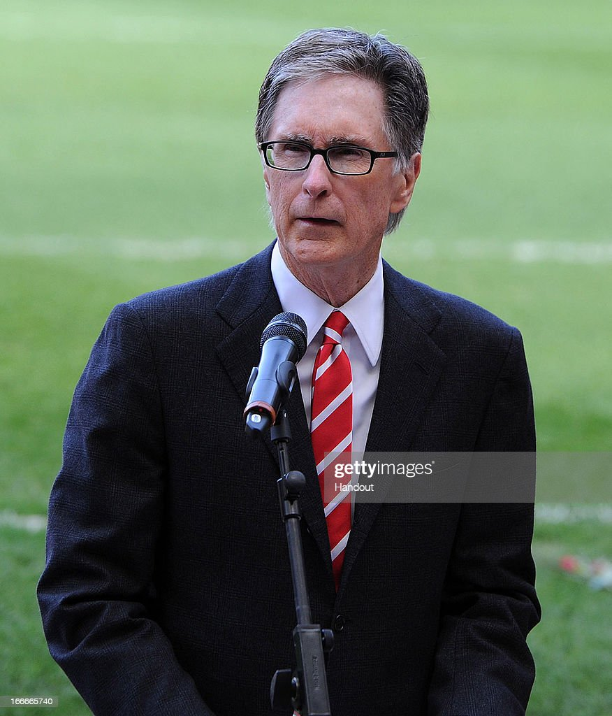 Pricipal owner John W Henry of Liverpool speaks at the 24th Hillsborough Anniversary Memorial Service at Anfield on April 15, 2013 in Liverpool, England. Thousands of fans, friends and relatives took part in the service at Liverpool's Anfield Stadium to mark the 24th anniversary of the Hillsborough disaster. A total of 96 Liverpool supporters lost their lives during a crush at an FA Cup semi final against Nottingham Forest at the Hillsborough football ground in Sheffield, South Yorkshire in 1989.