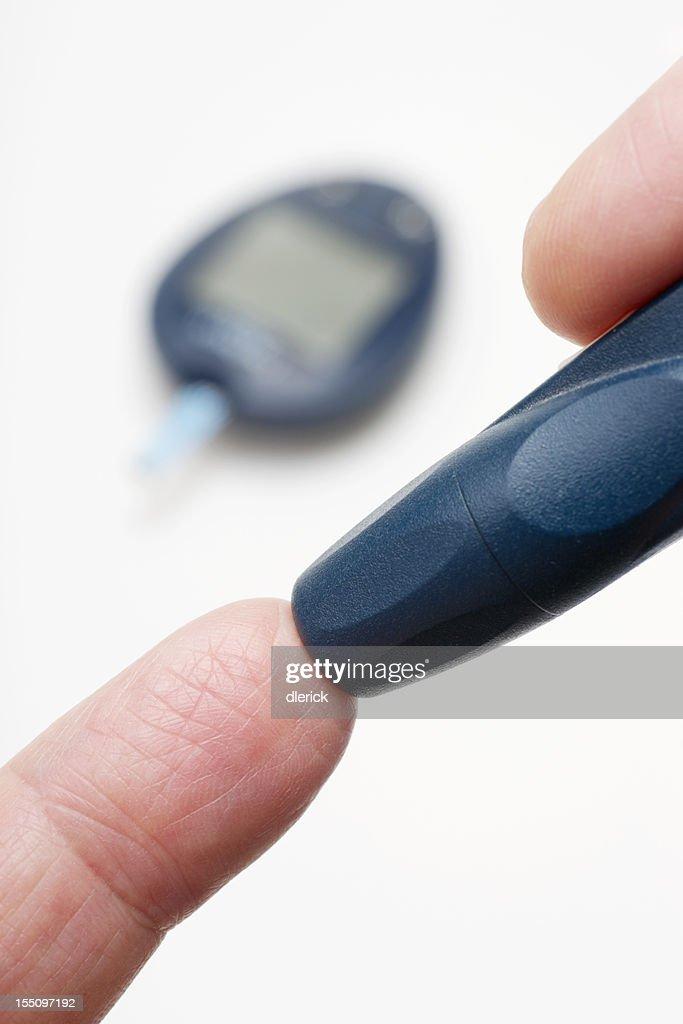 Pricking Finger for Blood Test : Stock Photo