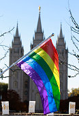 A pride flag flies in front of the Historic Mormon Temple as part of a protest where people resigned from the Church of Jesus Christ of LatterDay...