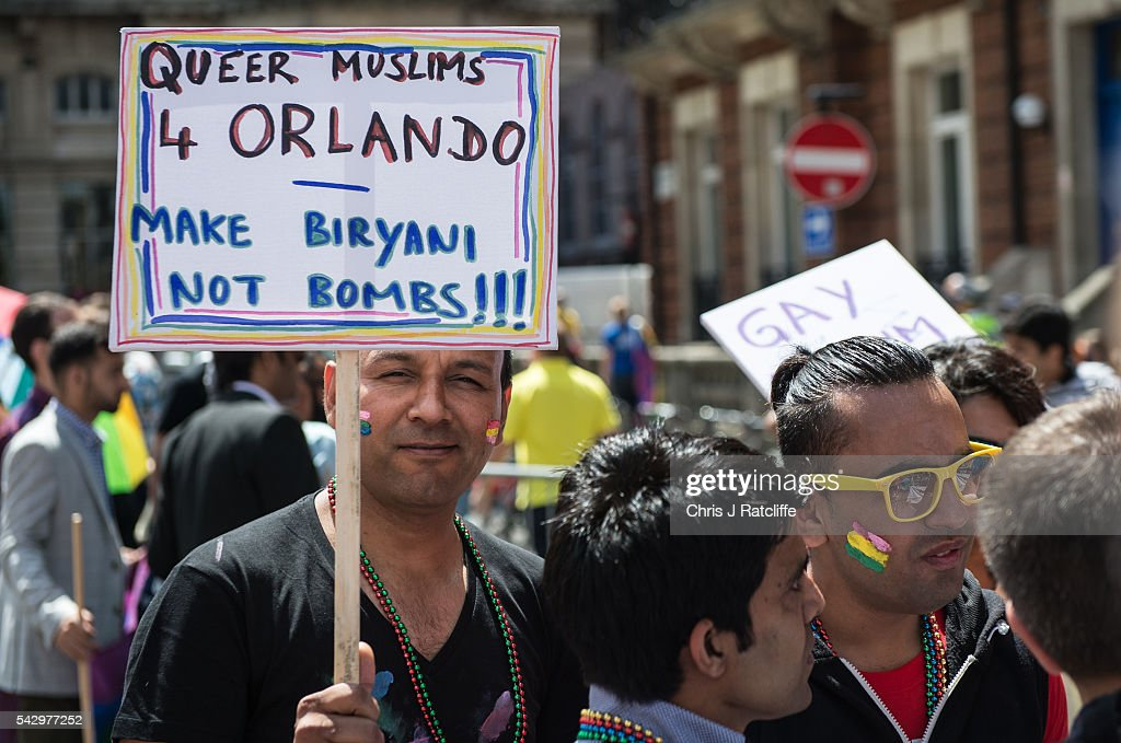 Pride marchers hold protest signs as the LGBT community celebrates Pride in London on June 25, 2016 in London, England. Across the city performances and speeches take place as a parade makes it way through the centre ending in Trafalgar Square. 2016 Pride in London comes just two weeks after Omar Mateen shot dead 50 people at Pulse, a gay nightclub in Orlando, Florida.