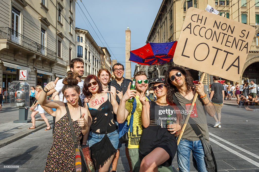 Pride marchers wave flags and hold up protest signs as the LGBT community celebrates Pride in Bologna on June 25, 2016 in Bologna, Italy. The parade is part of a World Pride Week and attracted thousands of marchers fighting for gay rights. 2016 Pride comes just two weeks after Omar Mateen shot dead 50 people at Pulse, a gay nightclub in Orlando, Florida.