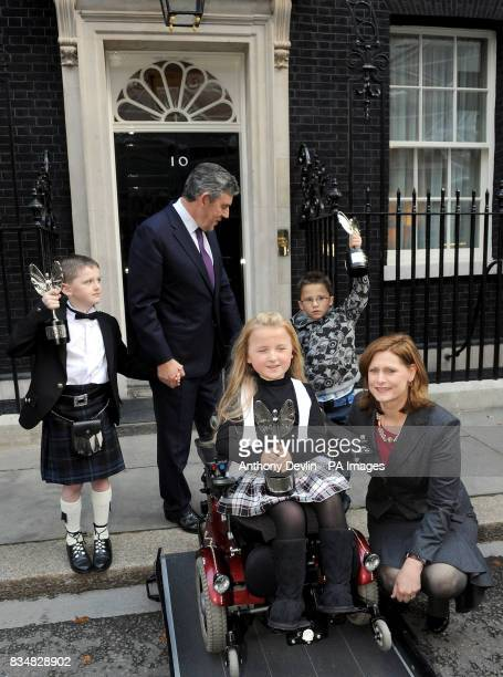 Pride of Britain winners Nathan Thomson Tilly Griffiths and Jaden Ashton pose with Prime Minister Gordon Brown and wife Sarah outside Downing Street...
